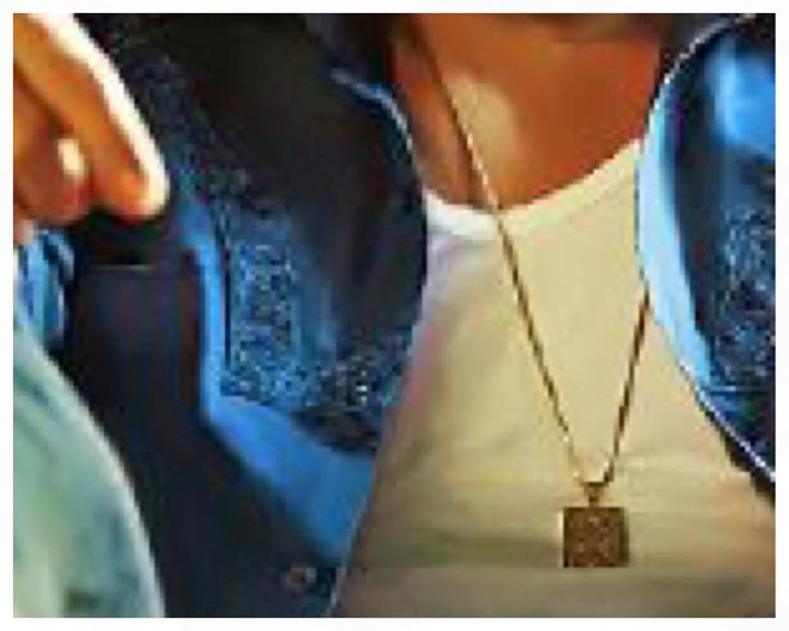 New poster out tonight. This is my personal locket with my parents pic in it. #RaeesTrailerTomorrow